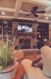 narrow family room decorating with fireplace under led tv over