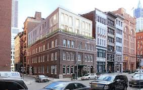 three story building glass addition proposed for three story brick building in tribeca