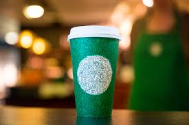 the green starbucks cup designed to bring people together is