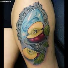 incredible apple core and mirror tattoo design on thigh golfian com