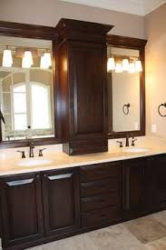 double sink vanity with middle tower colonial home s modern master bath renovation colonial bath and