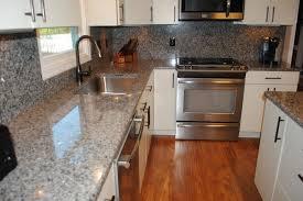 laminate kitchen backsplash caledonia granite tops and backsplash laminate floors white