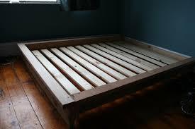 Slat Frame Bed Pine Wood Pallet Bed Frame With Wooden Slat Placed On Varnished