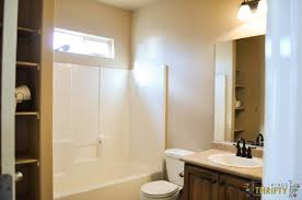 bathroom makeover from yucky tan to bright and airy all things