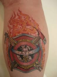 cross with iafc tattoo