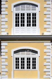 windows of a colonial mansion stock photo picture and royalty