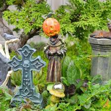 make your neighbors giggle with these 9 halloween fairy garden