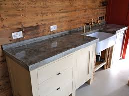 countertops rustic kitchen with wooden backsplash and concrete