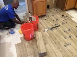 glamorous tile flooring that looks like wood in bathroom photo