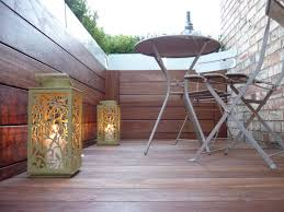 patio varnished wood balcony floor featuring green stain metal