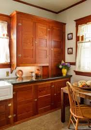 restored cabinets in a renovated craftsman kitchen old house