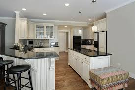Kitchens With White Cabinets And Black Countertops by 31