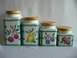 set of 4 square ceramic kitchen canisters wooden lids green white