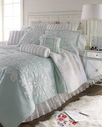 all white bedroom with lt blue accent color dena home