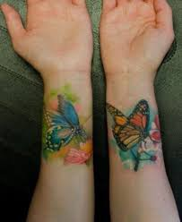 colored butterfly on wrist tatoos