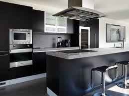 fascinating kitchen design with metallic chimney and awesome black