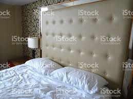 kingsize double bed large beige studded leather headboard