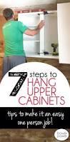 Installing Upper Kitchen Cabinets Cowboy Cabinets Upper Cabinets Kitchens And White Cabinets