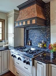 interior blue and white tile kitchen backsplash green grill range