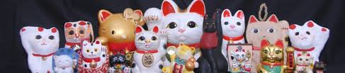 left paw or right black white or decoding the lucky cat