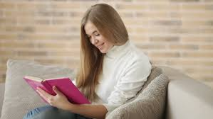 Happy Young Woman Lying On Sofa Using Laptop Looking At Camera And - Lying sofa 2