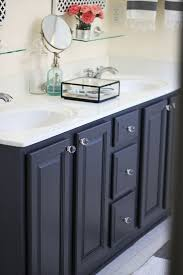 top navy bathroom vanity with white quartz countertop transitional