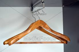 pair of wooden hangers in empty closet stock photo ta12186311