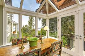 sunroom patio area with transparent vaulted ceiling wooden dining