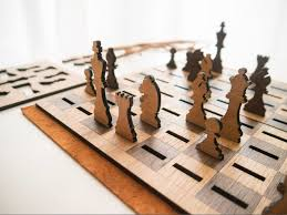 laser cut wooden chess set that flattens when not in use chess