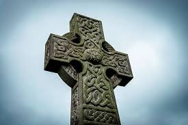 forest secretly grows into celtic cross