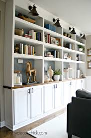 simplifying the library shelves from thrifty decor
