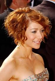curly bob hairstyle copper colored
