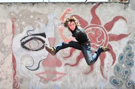 free images color graffiti curly hair smiling smile man person wall male jumping lifestyle