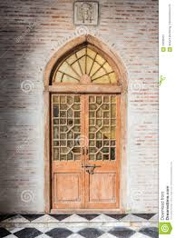 wooden front door with glass panels the wooden front door of a home with glass panels stock photo