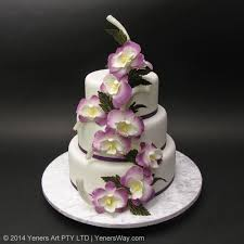 3 Tier Wedding Cake 3 Tier Wedding Cake With Cascading Purple Orchids Yeners Way