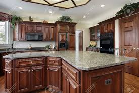kitchen in luxury home with large center island stock photo
