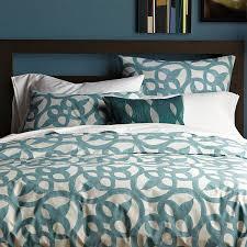 aqua blue architectural design printed on stone white organic duvet