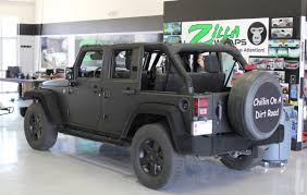 blacked out jeep matte black wrap jeep wrangler zilla wraps