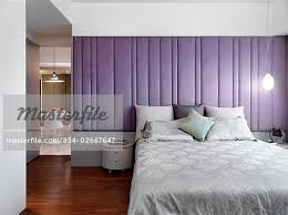 Padded Walls Modern Bedroom With Purple Padded Wall Stock Photo