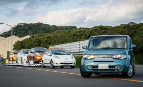 nissan leaf japanese to english nissan introduces leaf based driverless towing system at oppama