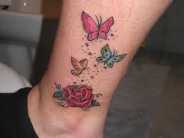 blue and butterfly thigh tattoos photos pictures and