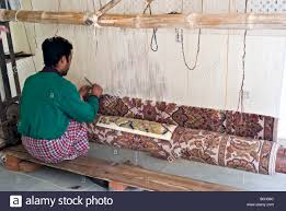 Wool Indian Rugs India Jaipur Young Indian Craftsman Working With A Pattern And