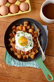 crispy aleppo pepper breakfast potatoes with sunny side up eggs