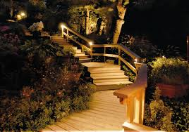 low voltage outdoor stair lights on the railing of the wooden