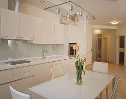 white small kitchen ideas with pendant light above kitchen island