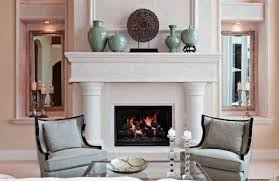 decorating a fireplace mantle with small statues and ornaments and