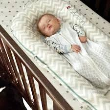 Baby Sleeping In A Crib by The Dockatot A Mom U0027s Best Friend U2013 Kaciegaston