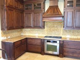 Alder Kitchen Cabinets by Knotty Alder Cabinets And Noce Backsplash Home Inspirations