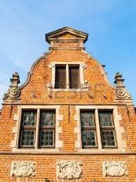 ancient brick house gable with ornamental windows architecture