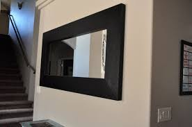 huge chunky black mirror all things thrifty